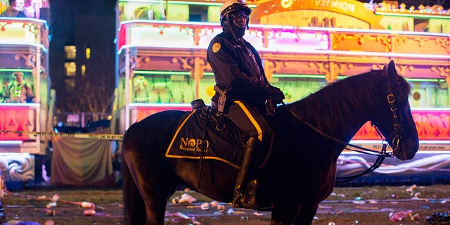 A police officer works the scene where a man was reportedly hit and killed by a float of the Krewe of Endymion parade in the runup to Mardi Gras in New Orleans, Saturday, Feb. 22, 2020. (Associated Press)