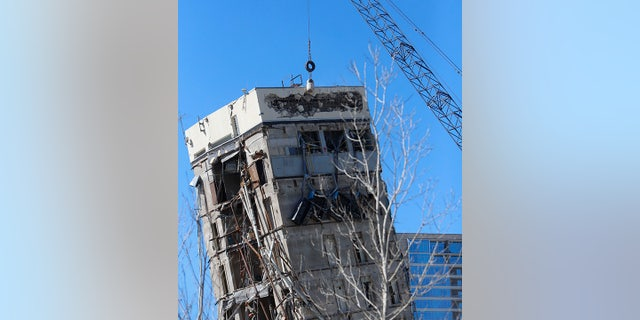 "A wrecking ball smashes against the ""Leaning Tower of Dallas"" north of downtown Dallas, Monday, Feb. 24, 2020."
