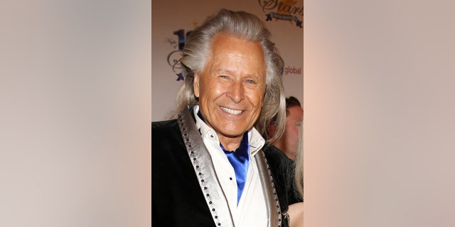A March 2014 photo of Peter Nygard. Federal authorities have raided the Manhattan headquarters of the Canadian fashion mogul amid claims that he sexually assaulted and trafficked dozens of teenage girls and young women. (Photo by Annie I. Bang /Invision/AP, File)