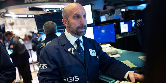 James Denaro monitors stock prices at the New York Stock Exchange, Wednesday, Feb. 26, 2020. (AP Photo/Mark Lennihan)