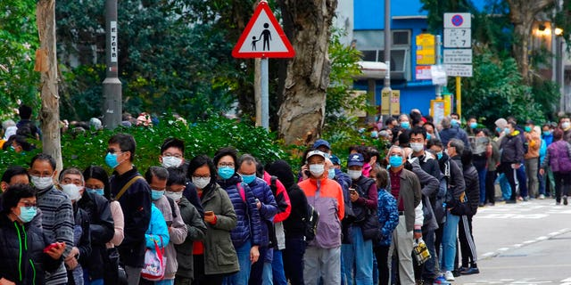 In this Feb. 5, 2020, file photo, citizens line up to buy face masks in Hong Kong. Fear of the spreading coronavirus has led to a global run on sales of face masks despite medical experts' advice that most people who aren't sick don't need to wear them.