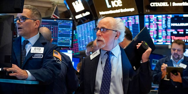 """The spirited stock man is shown in photos furrowing his brow, grabbing his head with a pained expression and hunched with his face in his hands. In others, he appears to be breathing a sigh of relief.<br data-cke-eol=""""1"""">"""