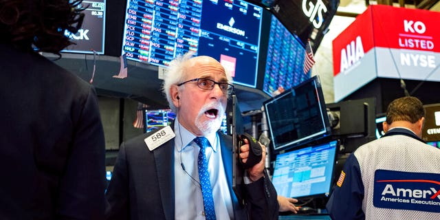 Trader Peter Tuchman works on the floor of the New York Stock Exchange Thursday, Feb. 27, 2020.