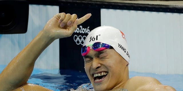 In this Monday, Aug. 8, 2016 file photo China's Sun Yang celebrates winning the final of the men's 200-meter freestyle during the swimming competitions at the 2016 Summer Olympics in Rio de Janeiro, Brazil.