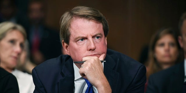 Then-White House counsel Don McGahn listens as Supreme court nominee Brett Kavanaugh testifies before the Senate Judiciary Committee on Capitol Hill in Washington. In a setback for Democrats in Congress, a federal appeals court has ruled that judges have no role to play in the subpoena fight between the House of Representatives and the Trump administration over the testimony of high-ranking officials. (Saul Loeb/Pool Photo via AP, File)