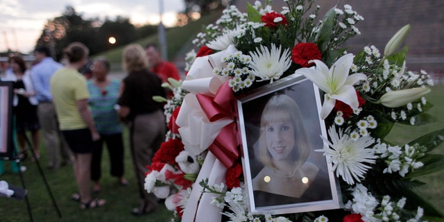 A photo sits amongst flowers at a candlelight vigil for Alison Parker on Martinsville High School's football field on August 27, 2015 in Martinsville, Virginia - file photo. Two employees of WDBJ TV were killed during a live broadcast at Bridgewater Plaza on Smith Mountain Lake on August 26, 2015.