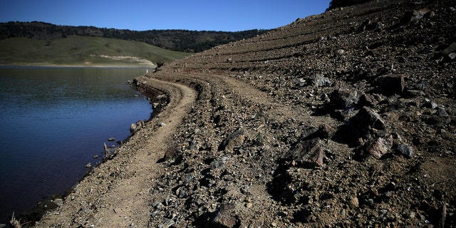 Water lines are visible along the banks of the Anderson Reservoir on February 25, 2020 in Morgan Hill, California.