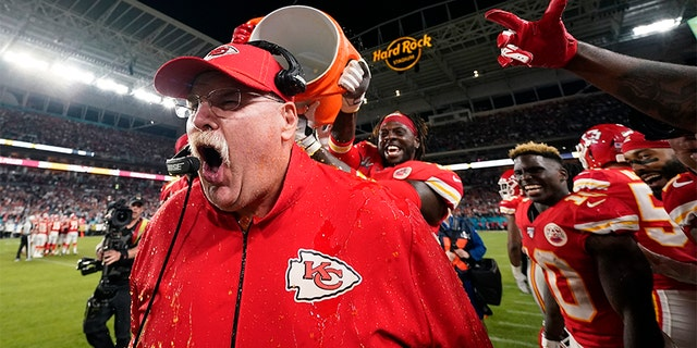 Kansas City Chiefs head coach Andy Reid reacts after being doused during the second half of the NFL Super Bowl 54 football game against the San Francisco 49ers Sunday, Feb. 2, 2020, in Miami Gardens, Fla. (AP Photo/David J. Phillip)