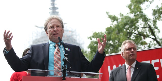 Andy Parker (L), the father of murdered TV reporter Alison Parker, speaks while flanked by Virginia Governor Terry McAuliffe (D) (R), during an anti-gun rally on Capitol Hill Sept. 10, 2015, in Washington, D.C.