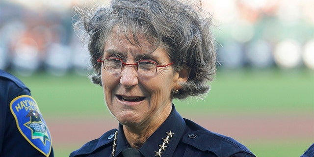 FILE - In this July 25, 2017 file photo, Oakland, Calif., Police Chief Anne Kirkpatrick stands before a baseball game between the San Francisco Giants and the Pittsburgh Pirates in San Francisco. (AP Photo/Jeff Chiu, File)