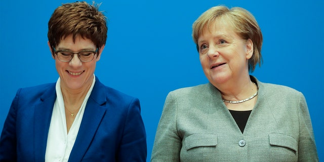 German Chancellor Angela Merkel, right, and CDU party chairwoman and Defense Minister Annegret Kramp-Karrenbauer, left, attend a party's board meeting at the headquarters in Berlin, Germany, Monday. (AP Photo/Markus Schreiber)