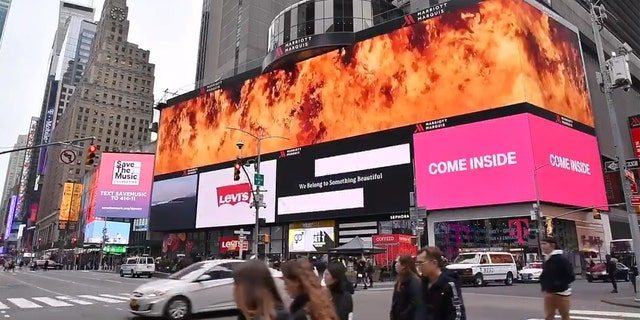 """The message displayed in Times Square read """"Imagine fighting a bush fire higher than this billboard"""" before being engulfed in flames."""