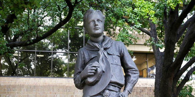 In this Wednesday, Feb. 12, 2020, photo, a statue stands outside the Boys Scouts of America headquarters in Irving, Texas. (AP Photo/LM Otero)