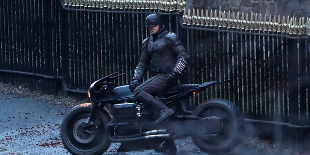 A man dressed as Batman sits on a motorcycle as filming continues in Glasgow for the new movie 'The Batman.'