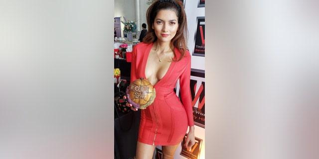Blanca Blanco with her 'Kobe' clutch.