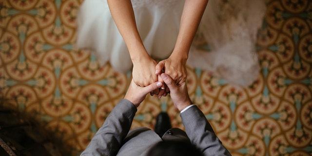 Westlake Legal Group Bride-and-Groom-iStock Thousands of couples tie knot in mass wedding amid coronavirus fears New York Post fox-news/world/world-regions/south-korea fox-news/lifestyle/weddings fox-news/health/infectious-disease/coronavirus fnc/lifestyle fnc article 5cf3b17b-d9ef-522e-b0da-dd8e2d60bc0e