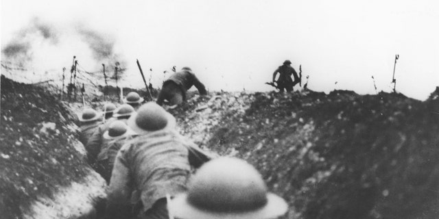 British soldiers leaving a trench to attack on the Somme, 1916.