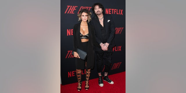 "Tommy Lee, right, and his wife Brittany Furlan attend the Premiere Of Netflix's ""The Dirt"" at ArcLight Hollywood on March 18, 2019 in Hollywood, Calif. (Photo by Paul Archuleta/FilmMagic)"