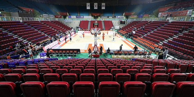 Stadium seats are empty during the Korean Basketball League between Incheon Electroland Elephants and Anyang KGC clubs in Incheon, South Korea, Wednesday, Feb. 26, 2020. The basketball game held without spectators as a precaution against the COVID-19. (Yun Tai-hyun/Yonhap via AP)