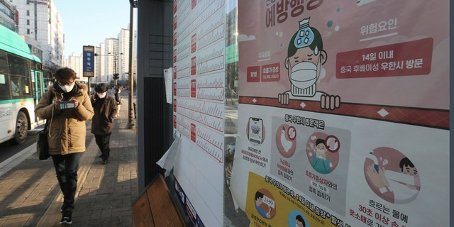 A poster detailing precautions to take against the coronavirus is seen at a bus station in Goyang, South Korea, Sunday, Feb. 23, 2020.