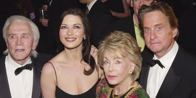 Kirk Douglas, Catherine Zeta-Jones, Anne Douglas, and Michael Douglas arrive at 'An Unforgettable Evening' presented by Saks Fifth Avenue benefitting Cedars-Sinai Medical Center March 27, 2001, at the Regent Beverly Wilshire Hotel in Beverly Hills, CA.