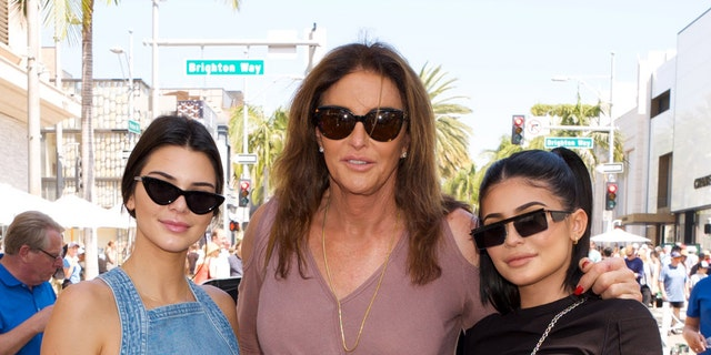 (L-R) Kendall Jenner, Caitlyn Jenner and Kylie Jenner pose for a photo as Caitlyn Jenner displays her Austin-Healey Sprite at the Rodeo Drive Concours d'Elegance on June 18, 2017 in Beverly Hills, Calif.