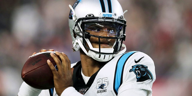 Aug. 22, 2019: Carolina Panthers quarterback Cam Newton warms up before an NFL preseason football game against the New England Patriots in Foxborough, Mass. (AP Photo/Charles Krupa)