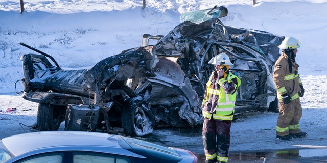 Emergency personnel gather at the scene following a multi-vehicle crash on the south shore of Montreal in La Prairie, Quebec, Wednesday, Feb. 19, 2020.
