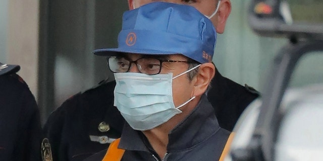 Ghosn wore a disguise when he was transferred from jail to house arrest after posting bail.