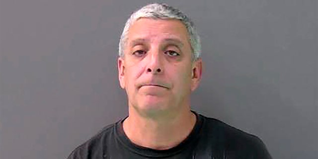 This Monday, Feb. 10, 2020, booking photo provided by the Bell County Jail shows Temple Police officer Carmen DeCruz. (Bell County Jail via AP)