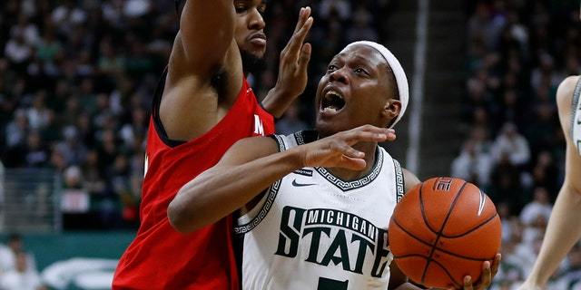 Cassius Winston led the Spartans to a Big Ten title in 2019. (AP Photo/Paul Sancya)