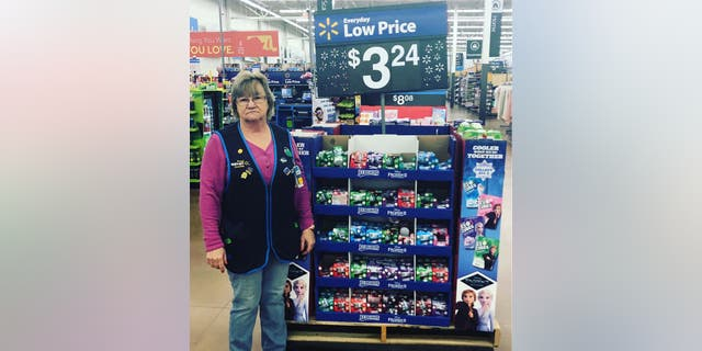 Charlene models her signature look in front of Walmart merchandise.