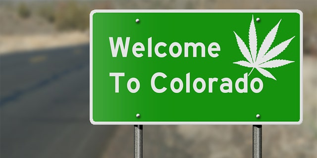 Highway sign as a reference to Colorado's laws regarding the use of marijuana. Cannabis companies are using the state's program to keep freeways clean as a tool to advertise amid tight restrictions on marijuana marketing.