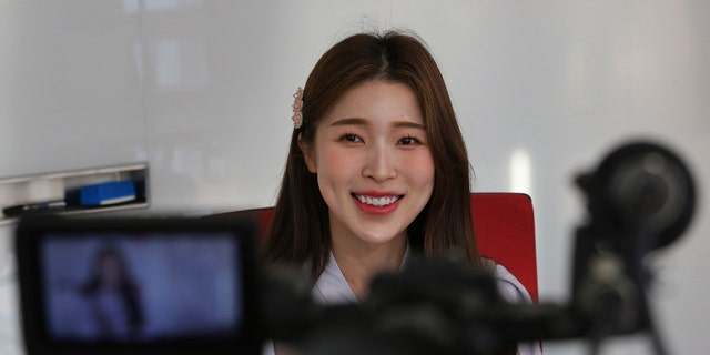 In this Thursday, Feb. 20, 2020, photo, Kang Na-ra, a Youtuber who defected in 2014, smiles during an interview in Seoul, South Korea. (AP Photo/Ahn Young-joon)