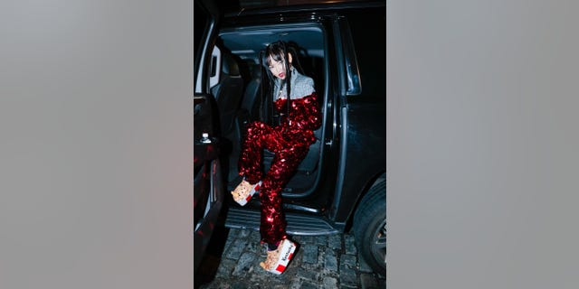 While attending shows during New York's biggest week in fashion, Global artist Me Love Me a Lot (MLMA) debuted the sky-high, platform avant-garde version of the Crocs classic clog.