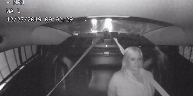 Image from a video showing Michigan state Rep. Rebekah Warren in the backseat of a patrol car after a drunk driving arrest on Dec. 26