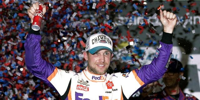 Denny Hamlin celebratinf in Victory Lane after winning the Daytona 500. (AP Photo/John Raoux)
