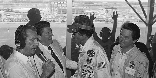 President Ronald Reagan congratulates stock car driver Richard Petty, who won the Firecracker 400 race at the Daytona International Speedway in Daytona Beach, Fla., in 1984. (AP Photo/Ira Schwarz, File)