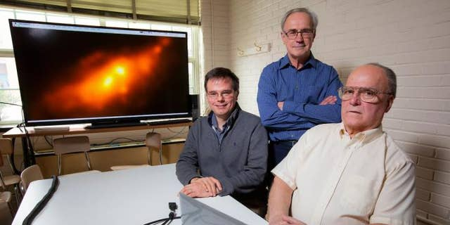 Iowa State astronomers -- left to right, Charles Kerton, Curtis Struck and Allen Lawrence -- have revealed a rare double-nucleus structure in a nearby and well-known galaxy.