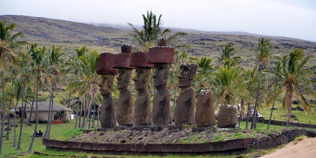 Ahu Nau Nau, a cultural and religious site built by Rapa Nui society on the north shore of Easter Island. The site is located on Easter Island's Anakena beach. (Photo by Robert DiNapoli)