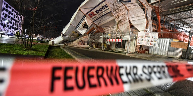 A scaffold has toppled over due to heavy wind in Freiburg, Germany, Monday, Feb. 10, 2020.