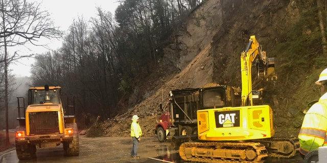 In this photo provided by the National Park Service, Great Smoky Mountains National Park and Federal Highways Administration staff clear mud and rock from the Spur connecting the Tennessee tourist towns of Gatlinburg and Pigeon Forge, near the Great Smoky Mountains National Park, Tuesday, Feb. 11, 2020.