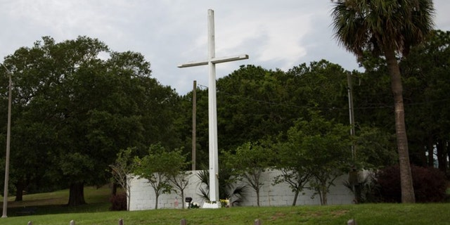 The historic 34-foot cross stands in Bayview Park in Pensacola, Florida.