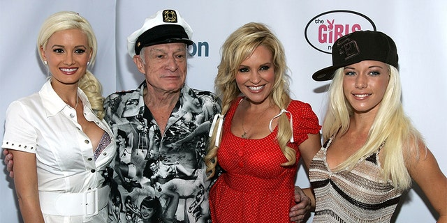 (L-R) Holly Madison, Hugh Hefner, Bridget Marquardt and Kendra Wilkinson attend the unveiling of Holly Madison's 'Girls Next Door'<br> jewelry collection at the Kitson Los Angeles boutique on July 29, 2006 in Los Angeles, California.