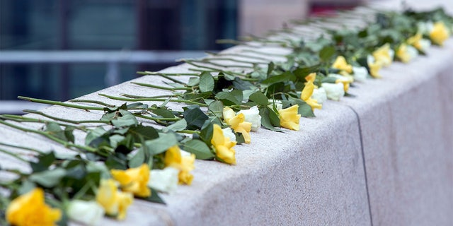 Flowers in the colours of Dresden are lying on the Altmarkt at a memorial to the victims of the bombing of Dresden in the Second World War 75 years ago, Dresden, Germany. (Jens Buettner/dpa via AP)