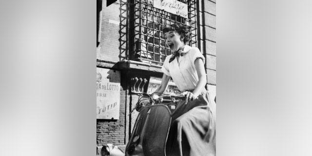 Audrey Hepburn gleefully drives a motorscooter on the set of 'Roman Holiday.'