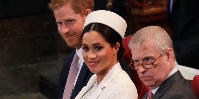 (L-R) Britain's Prince Harry, Duke of Sussex, Britain's Meghan, Duchess of Sussex and Britain's Prince Andrew, Duke of York.