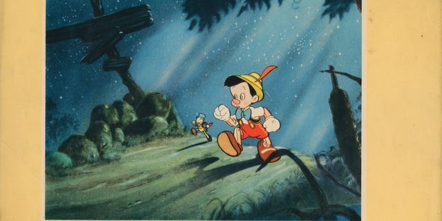 Jiminy Cricket and Pinocchio. (Photo by LMPC via Getty Images)