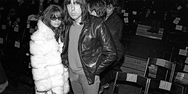 Johnny Ramone (R) and wife Linda pose for a photo during fashion week in 1994 in New York City.