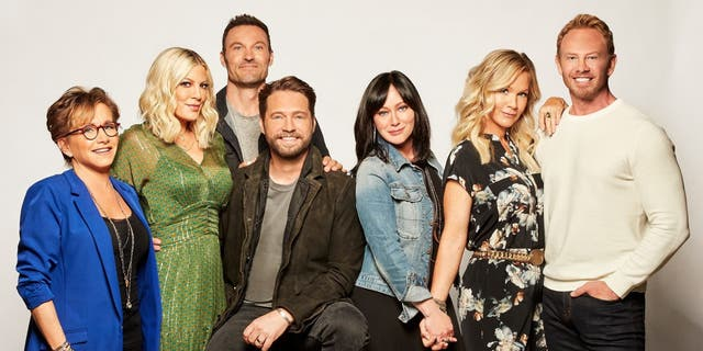 The stars of the 'BH902010' reboot from left-right: Gabrielle Carteris, Tori Spelling, Brian Austin Green, Jason Priestley, Shannen Doherty, Jennie Garth and Ian Ziering.